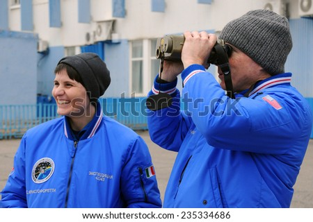 BAIKONUR, KAZAKHSTAN - NOVEMBER 12, 2014: ISS Expedition 42/43 crewmembers S.Cristoforetti (left) and T.Virts use laser range finder during training - stock photo