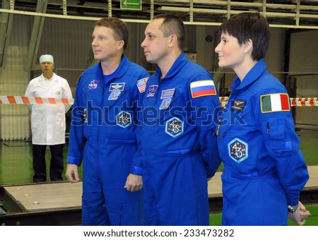 BAIKONUR, KAZAKHSTAN - NOVEMBER 19, 2014: ISS Expedition 42/43 crewmembers T.Virts (left), A.Shkaplerov (center), S.Cristoforetti (right) answer questions from reporters in Integration Facility - stock photo