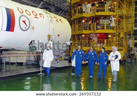 BAIKONUR, KAZAKHSTAN - NOVEMBER 12, 2014: ISS Expedition 42/43 crewmembers T.Virts (left), A.Shkaplerov (center), S.Cristoforetti (right) after fit check at the Cosmodrome Integration Facility - stock photo