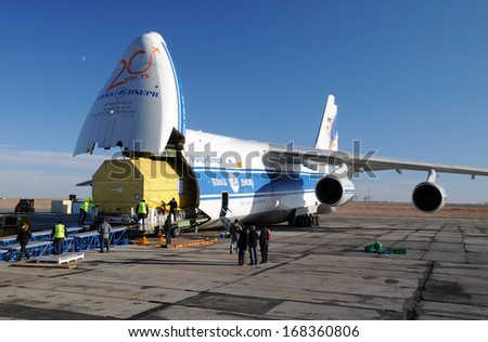 BAIKONUR, KAZAKHSTAN - NOVEMBER 11, 2013. Russian Volga-Dnepr Antonov AN-124 long-range heavy transport plane is being unloaded in Yubileiny airport.   - stock photo