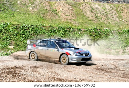 BAKAL, RUSSIA - AUGUST 8: Alexander Zheludov's Subaru Impreza WRX (No. 2) competes at the annual Rally Southern Ural on August 8, 2008 in Bakal, Satka district, Chelyabinsk region, Russia. - stock photo