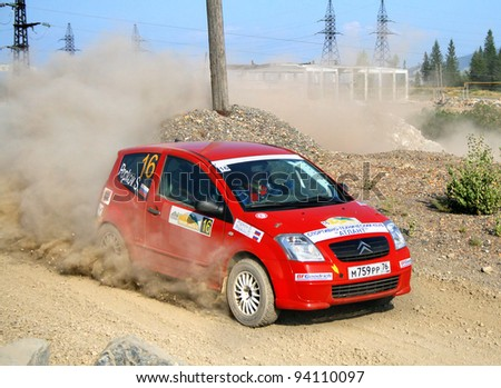 BAKAL, RUSSIA - AUGUST 13: Sergey Popkov's Citroen C2 (No. 16) competes at the annual Rally Southern Ural on August 13, 2010 in Bakal, Satka district, Chelyabinsk region, Russia. - stock photo