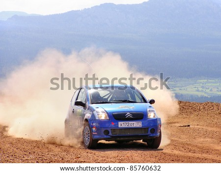BAKAL, RUSSIA - AUGUST 3: Yuriy Kirillov's Citroen C2 (No. 33) competes at the annual Rally Southern Ural on August 3, 2007 in Bakal, Satka district, Chelyabinsk region, Russia. - stock photo
