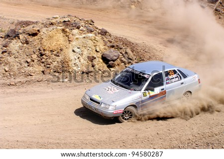 BAKAL, RUSSIA - JULY 9: Sergey Anisimov's LADA 110 (No. 39) competes at the annual Rally Southern Ural on July 9, 2011 in Bakal, Satka district, Chelyabinsk region, Russia. - stock photo