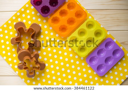 bake tools for cookie and cake mould for muffin and cupcake on white wooden background, top view - stock photo