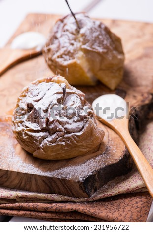 Baked apples on wooden board, selective focus