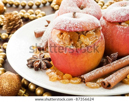 Baked apples with raisin, cottage cheese and walnuts. Shallow dof. - stock photo