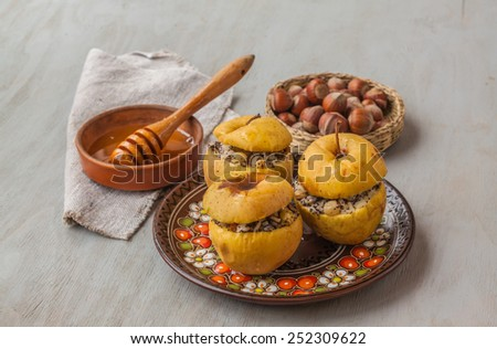 Baked apples with raisin, poppy seeds, rice and honey vegetarian ( lenten) meal. Selective focus on apples - stock photo