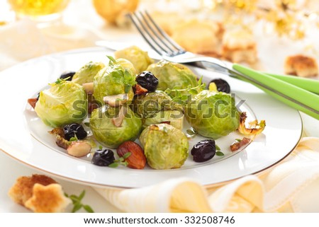 Baked Brussels sprouts with almonds and grapes for holidays.  - stock photo