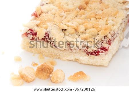 Baked cake on white plate - stock photo