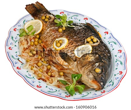Baked carp with fried onion and vegetables isolated on white by clipping path. - stock photo