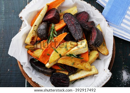 baked carrots and beets with herbs, food top view - stock photo