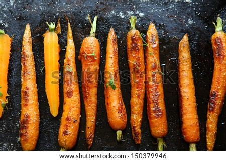 baked carrots on a baking sheet, food close up - stock photo