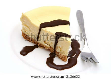 Baked cheesecake with chocolate sauce. - stock photo
