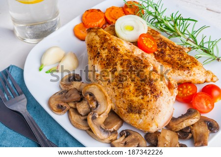 baked chicken breast with mushrooms - stock photo