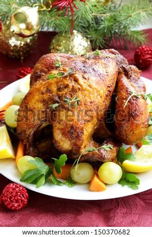 baked chicken for Christmas dinner, festive table setting - stock photo