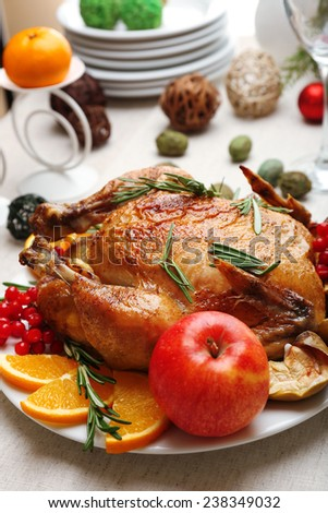 Baked chicken for festive dinner. Christmas table setting - stock photo