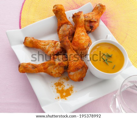 Baked chicken legs with curry sauce - stock photo