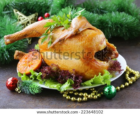 baked chicken or turkey for festive dinner, Christmas table setting - stock photo