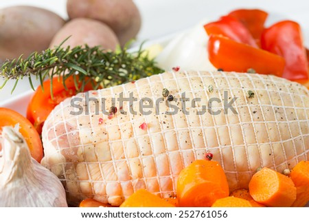 Baked chicken stuffed with fresh raw vegetables - stock photo