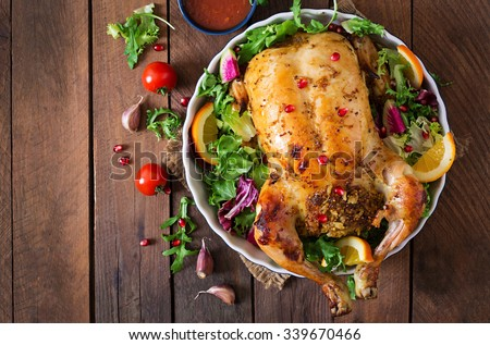Baked chicken stuffed with rice for Christmas dinner on a festive table. Top view - stock photo