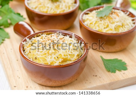 Baked chicken with mashed cauliflower and cheese in portions, closeup - stock photo