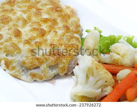 Baked cutlet with cauliflower and carrot garnish, isolated food still life, close up - stock photo