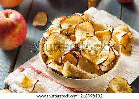 Baked Dehydrated Apples Chips in a Bowl - stock photo