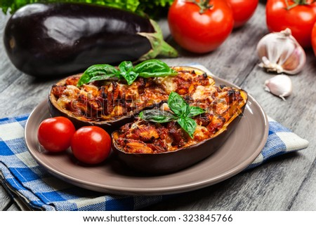 Baked eggplant with pieces of chicken in tomato sauce - stock photo