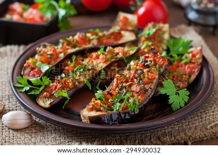 Baked eggplant with tomatoes, garlic and paprika - stock photo