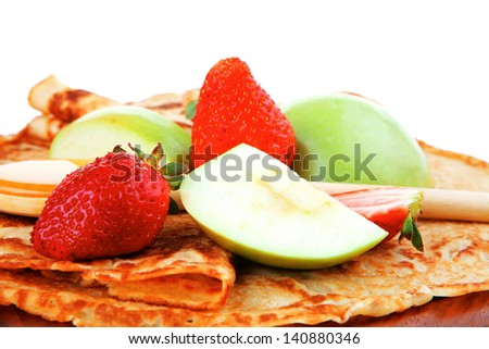 baked food : pancake with honey strawberries and apple isolated on white background