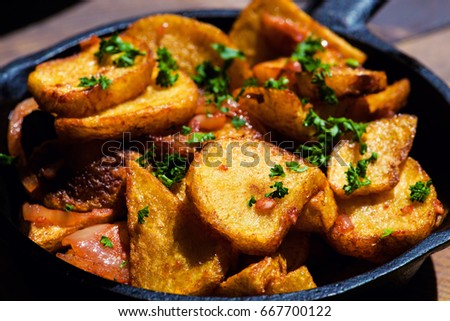 Baked Fried Potatoes With Garlic Dj0nd Onion