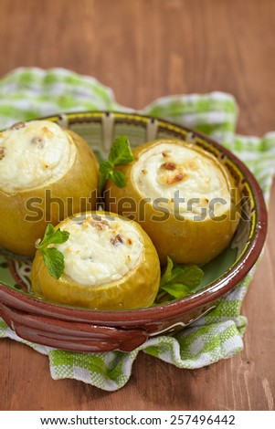 Baked green apple stuffed with sweet cream cheese and raisin - stock photo