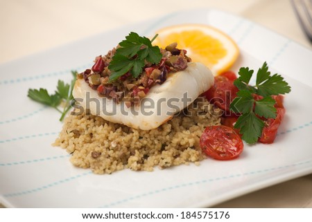 stock-photo-baked-halibut-with-olive-tapenade-crust-garnished-with ...