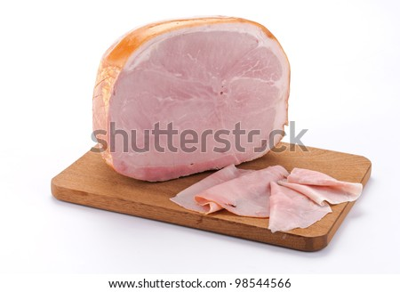 Baked ham with slices on wooden board - stock photo