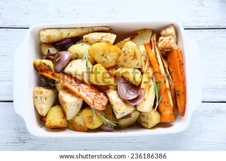 baked in the oven slices of vegetables top view - stock photo