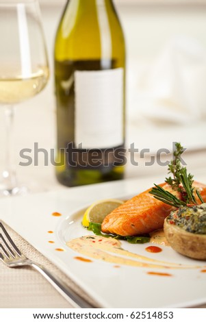 Baked Jacket Potato and Salmon Steak. Served with White Wine - stock photo