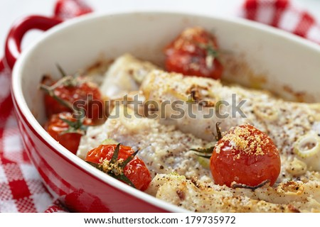 Baked kingklip�fish with cherry tomatoes - stock photo