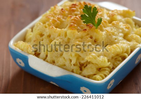 Baked Macaroni and Cheese in baking dish - stock photo