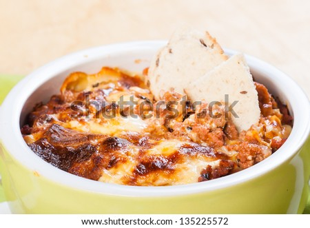 baked macaroni with side bread in a bowl - stock photo