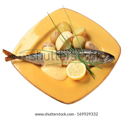 Baked mackerel with Hollandaise sauce and new potatoes - stock photo