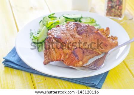 baked meat with salad from cucumbers