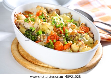 Baked mixed vegetable with chicken breast and oregano - stock photo