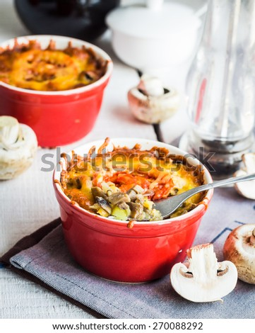 Baked mushroom julienne potatoes with cheese, vegetarian lunch on a white background - stock photo