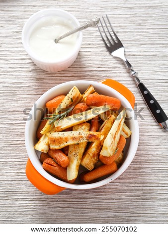 Baked parsnips and carrots in bowl, food - stock photo