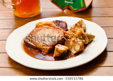 Baked pork chop with cabbage - stock photo