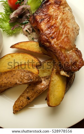 Baked pork on the bone and potatoes Catalan