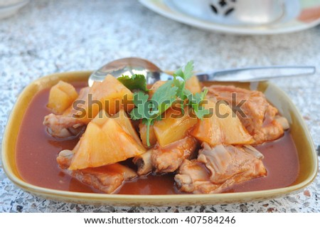 baked pork rib mixed pineapple in tomato sauce delicious of thaifood - stock photo