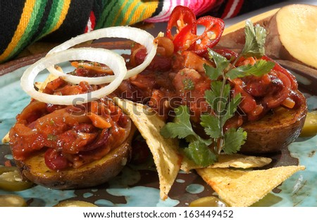 Baked potato filled w meat beans and salsa - stock photo