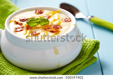 Baked potato soup with cheese and bacon - stock photo